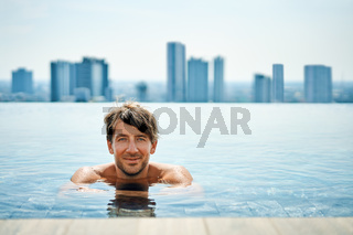 Handsome man relax in swimming pool