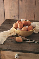 Fresh eggs on rustic wooden table
