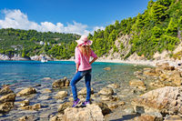 A woman at the beach Stafylos of Skopelos, Greece