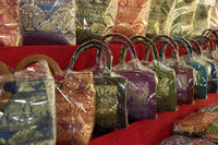 Lines of Thai handbags wrapped in plastic