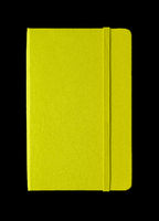 Lime green closed notebook isolated on black