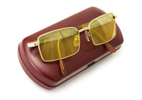 Anti-glare yellow driver's glasses on the  red case