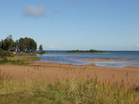 Sand beach at the shore of Lake Vanern, Sweden.