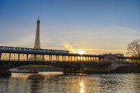 Paris France city skyline sunrise at Eiffel Tower and Seine River with Pont de Bir-Hakeim bridge and Paris Metro