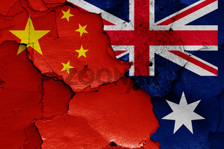 flags of China and Australia painted on cracked wall