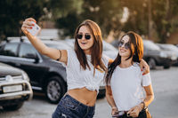 Two young women taking a selfie and have fun