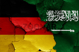 flags of Germany and Saudi Arabia painted on cracked wall