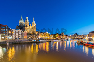 Amsterdam skyline with landmark buidings and canal in Amsterdam city, Netherlands