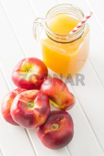 Ripe flat nectarines.