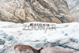 Tourists visit the Nigardsbreen Glacier, an arm of the Jostedalsbreen glacier, Jostedalsbreen National Park, Sogn og Fjordane, Norway, Scandinavia