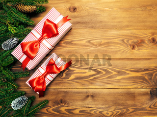 Fir branches on the wooden board. Wrapped gift boxes. Christmas and New year concept