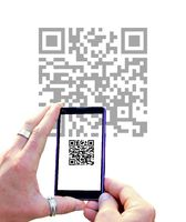 Scanning QR code with mobile phone.