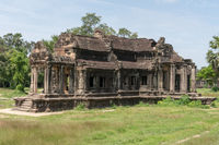 Ruined Angkor Wat stone temple in jungle
