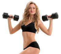 Curly athlete posing with dumbbells and stepper