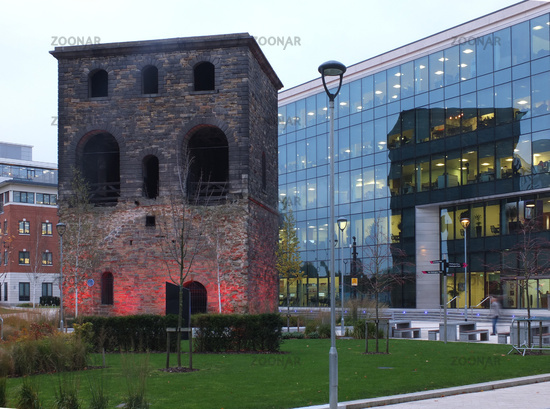 The historic railway lifting tower surrounded by modern buildings at wellington place in leeds