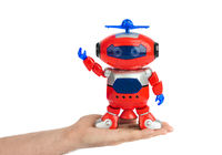 Hand with toy robot