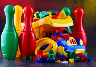 Composition with colorful plastic children toys.