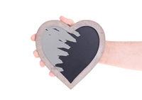 Adult holding heart shaped chalkboard