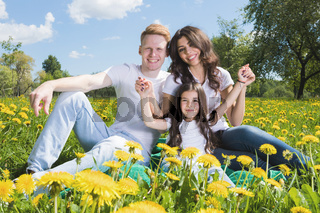 Family on flowers meadow