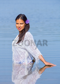 Colombian woman standing in natural water