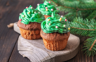Decorated cupcakes with Christmas tree branch