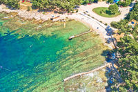 Camping by the sea and crystal clear stone beach aerial view in Savudrija