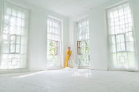 Loneliness Concept. A Woman In A Yellow Dress Is Standing In The Corner
