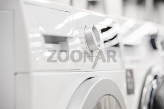 washing mashines closeup in appliance store