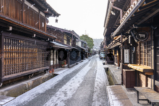 Takayama old town with snow falling in Gifu, Japan