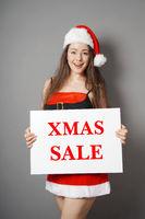 miss santa presenting xmas sale sign