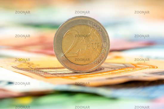 Two Euros on Euro banknotes background