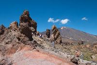 People at Roque Cinchado rock at Roques De Garcia Parque Nacional Del Teide Tenerife Spain
