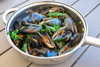 Steamed mussels in a pot. Delicious seafood plate.