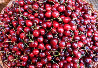 Heap of fresh red cherries in basket