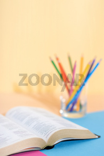 Bible and set of colored pencils ready for study