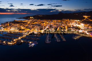 Aerial view of city port at night.