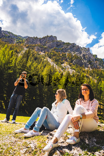 Gruner See, Austria 16.05.2017: Peaceful mountain view with famous green lake in Styria. Turquoise green color of water. Tourists sitting on the shore. Travel destination