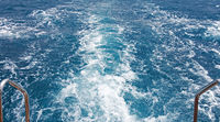 Travel destination motor boat water traces in open caribbean sea.