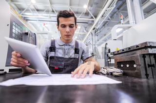 Man working with documents at plant