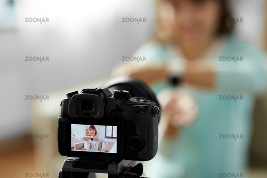asian blogger makes video blog of smart watch