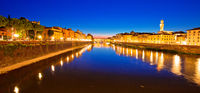 Ponte Vecchio bridge and Arno river waterfront in Florence evening view