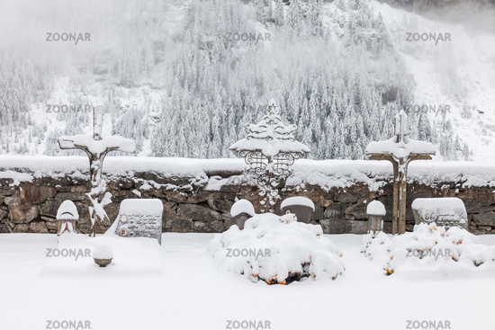Snow-covered grave crosses in the cemetery