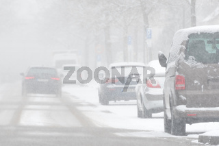 Driving car in heavy snowfall
