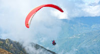 Paragliders over mountain