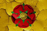 flag of Lancashire painted on cracked wall