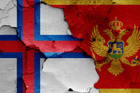 flags of Faroe Islands and Montenegro painted on cracked wall