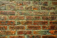 Red Green old worn brick wall texture background.