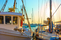 Fishing boats in the port at sunset