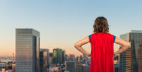 woman in red superhero cape over tokyo city
