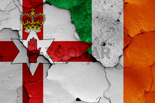 flags of Northern Ireland and Ireland painted on cracked wall
